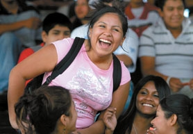 by: Jaime Valdez, SCHOOL IS COOL — Caren Corona, a Tigard High School sophomore, is exuberant after winning a raffle prize during a Latino orientation event Monday. Raffle prizes included THS bucks and McDonald's gift certificates.