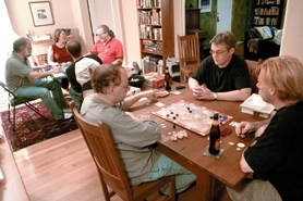 by: JONATHAN HOUSE, The owners of Sunriver Games typically participate in gaming nights, such as the one held at Matt Gagan's apartment last week. Most of the time they use these meetings to bounce ideas off one another and playtest new games.