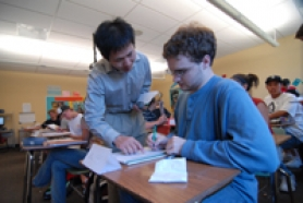 by: Vern Uyetake, Andy Wang, a teacher in the Lake Oswego School District, explains part of a lesson to student Matthew Salser during the district's new beginning Chinese class on Monday at Lake Oswego High School.