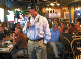 by: JIM CLARK, Joking that he knew they'd be firing some tough questions at him, Winter Hawk co-owner Jack Donovan donned a hockey helmet before opening the floor to fans at a public forum Tuesday at Claudia's sports bar in Southeast Portland.