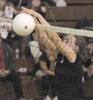 by: David Ball, Corbett's Mallory Spanjer goes up for a block in the middle of the net during the Cardinals' sweep against DeLaSalle on Thursday night.
