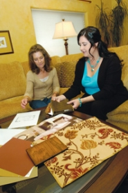 by: Carole Archer, Cristy Mosset, left, looks at fabric samples brought to her home by Design Consultant Cathy Moody, who works for La-Z-Boy's Gresham store. Mosset used Moody's complimentary design services to create a living room with soft fabrics and warm, rich tones.