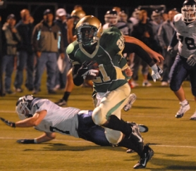 by: vern Uyetake, Jesuit's Raphiel Lambert breaks loose for a 15-yard touchdown run,