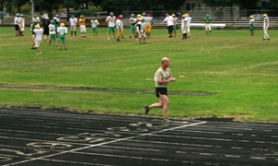 by: JIM CLARK, While Rick Macquoid makes his daily run at the track at Cleveland High School in Southeast Portland, the school's football team practices on the field. A multiyear fundraising effort still has $1 million to go to complete the track and field project.