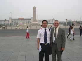 by: Contributed Photo, Estacada Superintendent Mike Call and Carl Ma, deputy director of Education for Hunan Province, visit Tieneman Square in China this summer.
