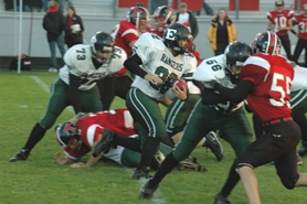 by: Clinton Vining, Senior full back Greg Locke (32) cuts behind junior center Myles Dunlop's (56) block Friday night in Tillamook. The Cheesemakers beat the Rangers 26-7.