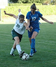 by: Clinton Vining, Estacada mid-fielder Kim Wilkin dribbles around her Valley Catholic opponent last Tuesday in Estacada.