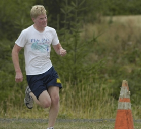 by: David Ball, Barlow's Eric Lagerstrom attacks a hill during a recent cross country practice. He joined the racing squad as a sophomore to improve his running ability for triathlons.