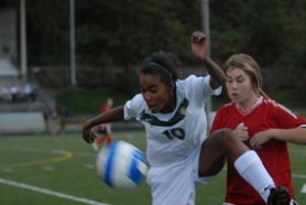 by: Vern Uyetake, West Linn's Jazmine Whitlock gets acrobatic while trying to bring down a loose ball in last Tuesday's 3-2 victory over Clackamas. Whitlock had an assist on the team's winning goal in the contest.