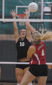 by: Vern Uyetake, Lacey Mannex goes up for a block in her team's convincing three-set victory over Oregon City on Tuesday.