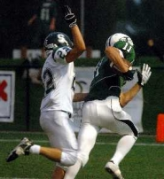 by: DAN BROOD, TD BOUND — Tigard's Chase Dalton (11) heads to the end zone after catching a pass from Patrick Chabreck.