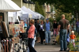 by: David Plechl,  Visitors walk past paintings and other artwork at the Village of Willamette Arts Festival in West Linn last weekend.