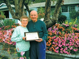 by: Christina Lent, Margaret and Valentine Bauer were recently honored for their Highland neighborhood garden.