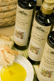 by: ©2006 DOREEN WYNJA, Red Ridge Farms has a producer in California bottling Arbequina olive oil under its label this year. Penny and Ken Durant hope to begin pressing their own from Oregon-grown olives in 2008.
