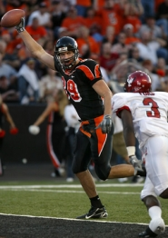 by: L.E. BASKOW, Oregon State's Joe Newton celebrates a touchdown after a catch in the Beavers' season opener against Eastern Washington.