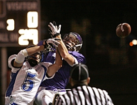 by: MILES VANCE, ALMOST — Sunset junior tight end Andrew Pollard (right) sees the ball batted away by South Medford's Dylan Anderson during the first quarter of the Panthers' 24-14 win at Sunset High School on Friday night.