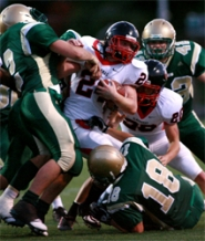 by: craig mitchelldyer, West Linn defenders gangtackle Clackamas star running back Brad Wagner during Friday's 28-23 upset.