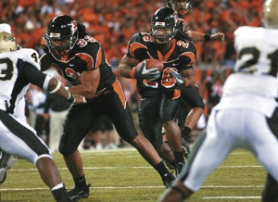 by: DENISE FARWELL, Yvenson Bernard ran for 117 yards in a 38-0 win over Idaho.