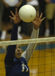 by: David Ball, Gresham's Erica Vrvilo goes above the net for a block during the Gophers' three-game loss to Central Catholic on Monday Night.