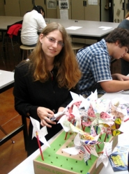 by: Carole Archer, Students at Reynolds High School work on pinwheels that they planted around the Reynolds Arts and Communications building to mark the International Day of Peace on Thursday, Sept. 21.