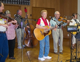 by: Bob Schoenberg, Dorothy Wehus leads the band in a country and western classic with the Old Time Fiddlers Sept. 3 at the King City Civic Association. Town Hall.