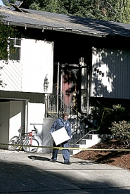 by: Jaime Valdez, A Beaverton police investigator was among those combing through the fire-damaged house on Southwest Nehalem Lane Tuesday to find clues about the blaze and the gunshots reported early in the day.