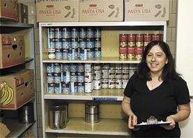 by: Chase Allgood, Director Martha Ochoa takes inventory inside the Forest Grove Family Resource Center.