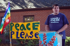 "by: Barbara Adams, House District 51 representative candidate Ryan Olds spoke at the peace rally Saturday, saying, ""Peace starts at the local level."""