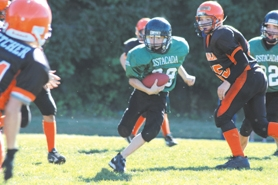 by: Clinton Vining, Shane Licari (center) finds daylight between the Molalla defense in Saturday's seventh-grade 20-0 shutout at Estacada High School.