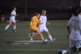 by: Vern Uyetake, Taylor Brooke, left, fights past a Lake Oswego defender in last Thursday's 5-0 loss. West Linn fell to 2-1-1 in league and is now in third place. After a bye on Tuesday the Lions take on Milwaukie this Thursday.