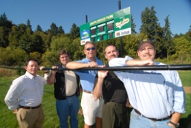 by: Vern Uyetake, Showing pride in one of the two new scoreboards that Safeco Insurance donated to Fields Bridge Park are, from left, Scot Gelfand, Gelfand Insurance Group; Joe Monahan, coordinator, West Linn Baseball; Ken Worcester, parks and recreation director; Rich Williams, board president, West Linn Baseball; and Tom Trussell, graphic designer with MediaWorks.