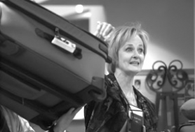 by: Matthew Sherman, Wendy Liebreich from Portland Luggage gives a demonstration on how to pack for trips quickly and efficiently at Oswego Place Assisted Living Community last Saturday as part of a fund-raising event for the Susan G. Komen Breast Cancer Association.