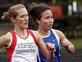 by: MILES VANCE, STEP FOR STEP — Valley Catholic senior Laura Ueki (right) ran step-for-step with Westside Christian's Abigail King most of the way during the Oregon Episcopal Invitational last week. King ran to first place and Ueki to fifth, but both were later disqualified for taking a wrong turn on the course.