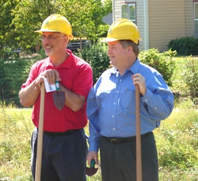 by: Jessie Kirk, Neighborhood House's Executive Director Rick Nitti and William Wilson Architect's Bill Wilson help shovel dirt at the groundbreaking ceremony for the Watershed affordable housing development on Sept. 7.