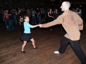 by: COURTESY OF LARRY PEACOCK, Eleven-year-old Natalie McKee takes Oregon Dance Fair organizer Larry Peacock for a twirl across the floor.