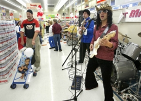 "by: TRIBUNE PHOTO: JIM CLARK, While Hit Machine supplies the tunes, Southeast shoppers last week check out the new addition to the neighborhood. Many observed, ""I can't wait to walk to the grocery store."""