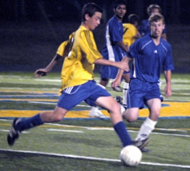 by: David Ball, Barlow freshman Steven Evans dribbles past Gresham's Kevin Pilcher during the Bruins' 5-0 win Thursday night. Evans assisted on Barlow's second goal of the game.