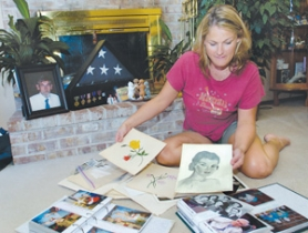 by: Carole Archer, Sarah Carpenter, 40, goes through old photos and memorabilia of her mother, Joanne Martinson, 75, who suffered from Alzheimer's and died Thursday, Sept. 28. Carpenter discovered her mother's artistic ability as she was readying her parents home for sale last year and came across her drawings and paintings.