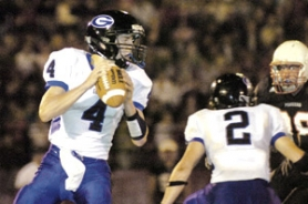by: Carole Archer, Gresham quarterback Daniel Gilbertson drops back to pass during the Gophers' 35-28 loss at Sandy on Friday night.