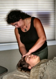 by: Elizabeth Ussher Groff, Angela Tisci administers acupuncture to Sarahbeth Price at her new Woodstock Wellness Center.