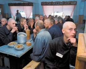 by: COURTESY OF BLUE SKY GALLERY, Carl de Keyzer's gulag travelogue of Siberian prison camps is on display at Blue Sky Gallery, including this look at a bread-and-sardine lunch at a camp in the Krasnoyarsk region.