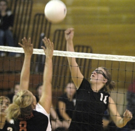 by: David Ball, Corbett hitter Caitlin Spanjer punches a ball back over the net during the Cardinals' four-game win against Nestucca on Tuesday night.