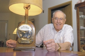 by: file photo, Vic Bacon with a lamp that he received as a retirement gift from PGE - an electric meter.