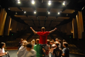 "by: Vern Uyetake, Teen thespian David Burke is elevated Monday evening during a rehearsal for West Linn High School's upcoming play ""Crazy For You.""  The new 600-seat auditorium is one of the areas featured in a dedication and open house Tuesday."