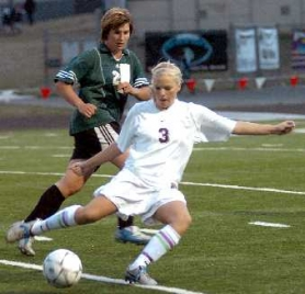 by: DAN BROOD, SMOOTH — Sherwood's Emily Schulte gets ready to boot the ball in the Lady Bowmen's 3-0 win over Parkrose.