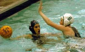 by: DAN BROOD, IN THE POOL — Tualatin's Iainee Perala looks to keep the ball away from Tigard's Melissa Myers.