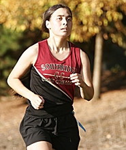 by: MILES VANCE, ON HER OWN — Southridge senior Perrin Considine shook off last week's 85-degree heat and the rest of the competition to win her team's meet against Beaverton and Westview.