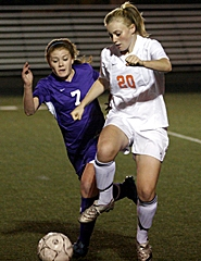 by: MILES VANCE, ON THE BALL — Beaverton junior Alli Hubbard (right) and Sunset sophomore Eric Carney race to the ball during Sunset's 3-2 Metro League victory on Monday night.