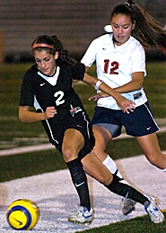 by: JOHN LARIVIERE, IN MOTION — Southridge midfielder Ana Montoya (left) eludes Westview's Jesi Wichershiem during Westview 2-1 victory over Southridge.