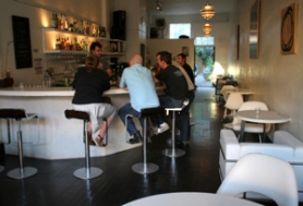 by: DENISE FARWELL, The all-white interior of Moloko Plus serves to highlight the thirsty hipsters within.